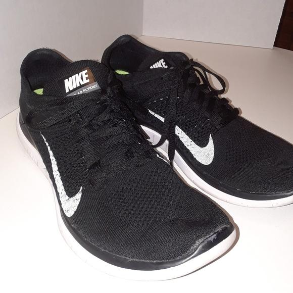 9e739934e5 Nike unisex free 4.0 flyknit black running shoes. M 5a8a29b236b9def1ed214334